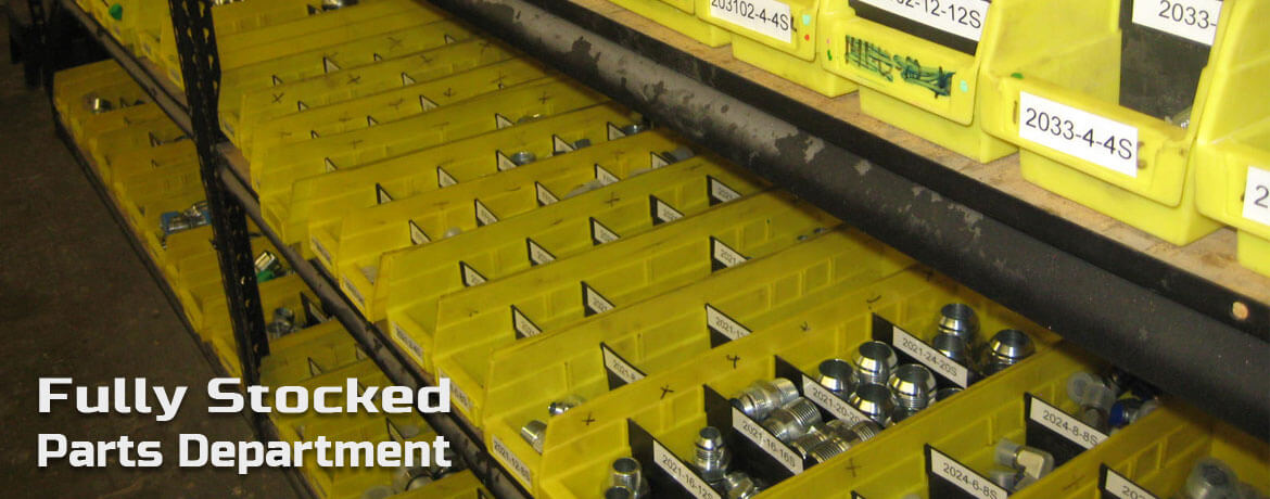 Rows of bins containing hydraulic parts
